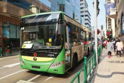 Green city bus parked at bus stop | CDL practice test