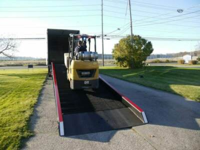 Forklift traveling up Copperloy loading ramp