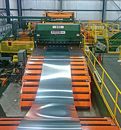 Sheet metal feeding into cut to length and slitting line machinery