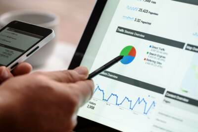 Person pointing to data screen with a stylus   Greenhouse marketing and SEO