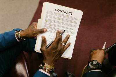 A person holding a contract   Workers comp attorneys near me